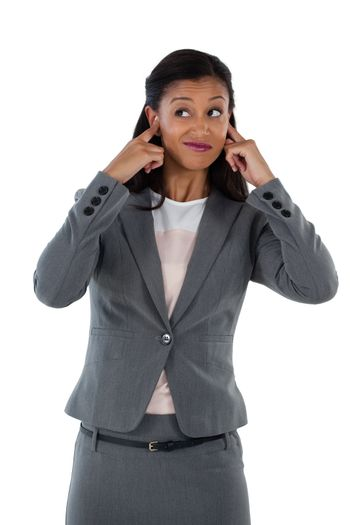 Irritated businesswoman covering her ears