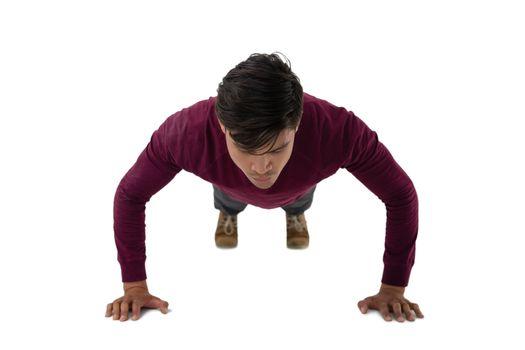 Businessman doing push ups