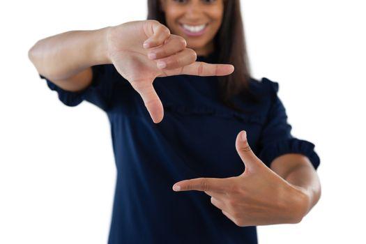 Female executive forming a finger frame