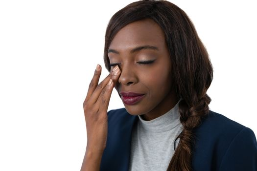 Close up of businesswoman rubbing eyes