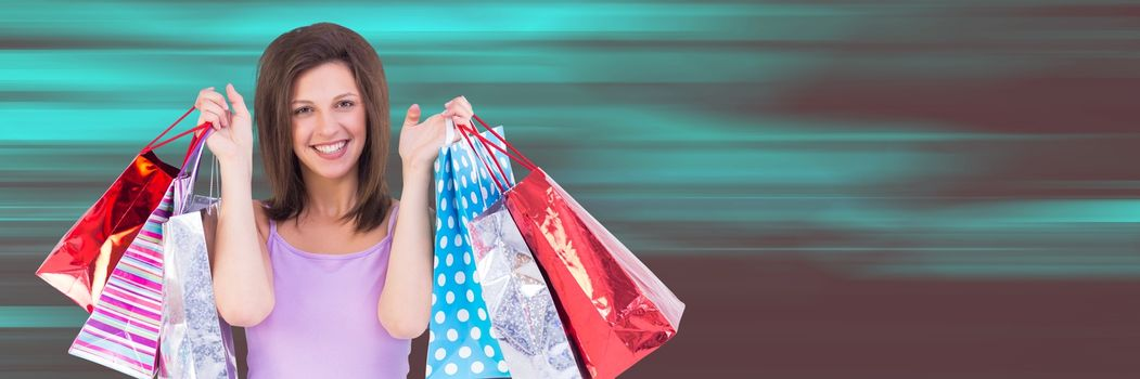Shopper holding up bags against blurry teal and red background