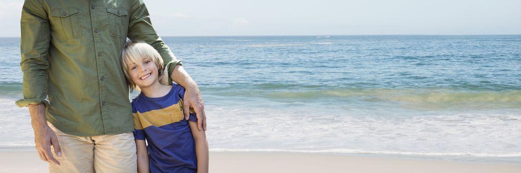 Father arm around sun against beach