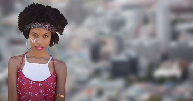 Hippie woman against blurry city