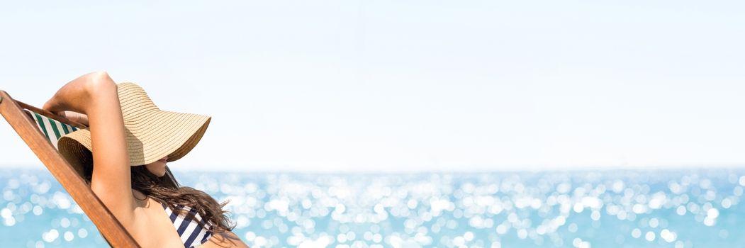 Woman sunbathing against blurry horizon