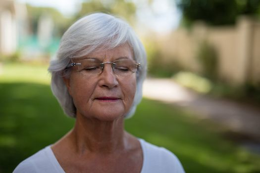 Senior woman with closed eyes