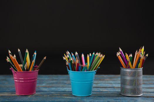 Color pencils arranged in pencil holder