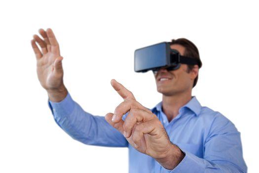 Businessman gesturing while wearing virtual reality simulator