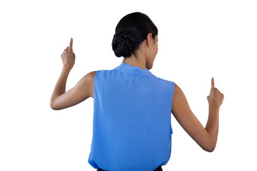Businesswoman in sleeveless clothing pointing on interface