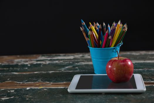 Apple on digital tablet with pen holder