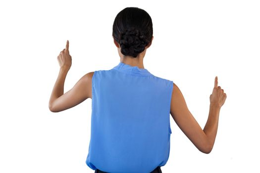 Rear view of businesswoman in sleeveless clothing pointing on interface