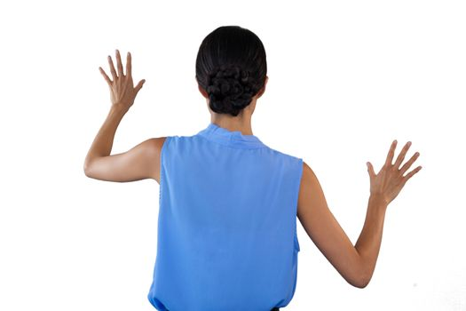 Businesswoman in sleeveless clothing touching interface