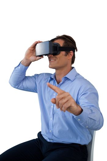 Businessman pointing while wearing virtual reality simulator
