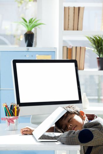 Businessman with closed eyes taking nap on laptop at desk