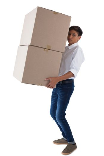 Boy carrying heavy boxes