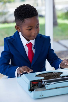 Businessman using typewriter