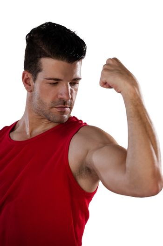 Male thlete flexing muscles