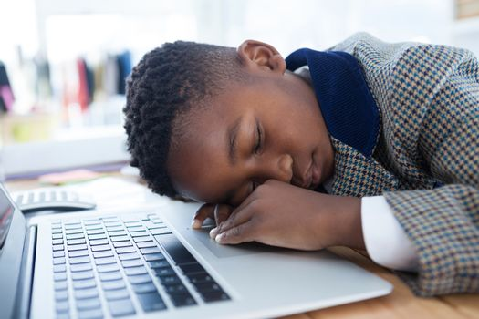 Businessman taking a nap on laptop