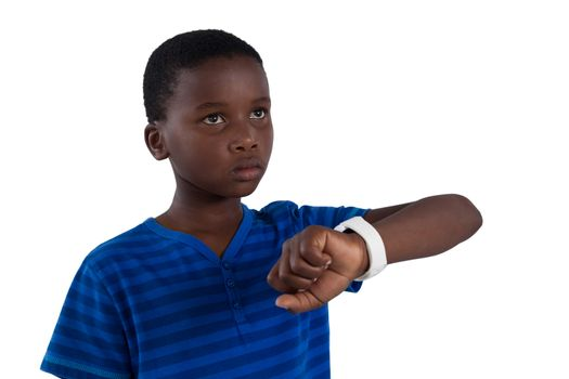 Thoughtful boy with smart watch