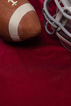 American football and helmet on jersey
