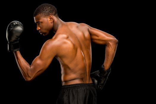 Shirtless muscular boxer