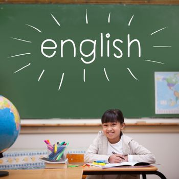 The word english against cute pupil sitting at desk