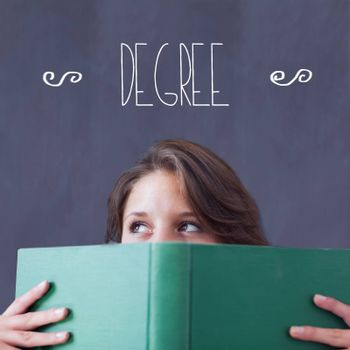 The word degree against student holding book