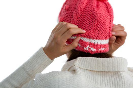 Rear view of woman wearing knit hat