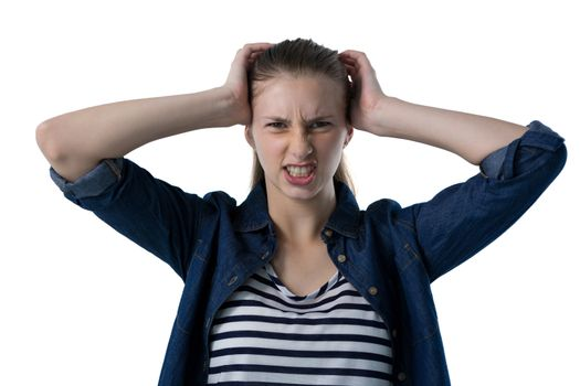 Frustrated teenage girl scratching her head
