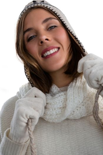 Portrait of smiling woman holding knit hat