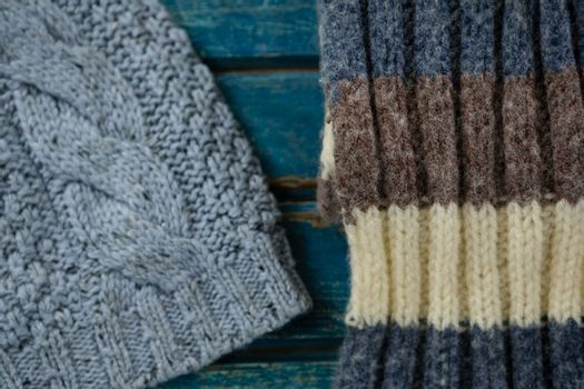 Close up of knit hand and scarf