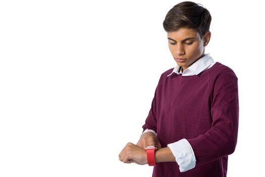 Teenage boy using smartwatch
