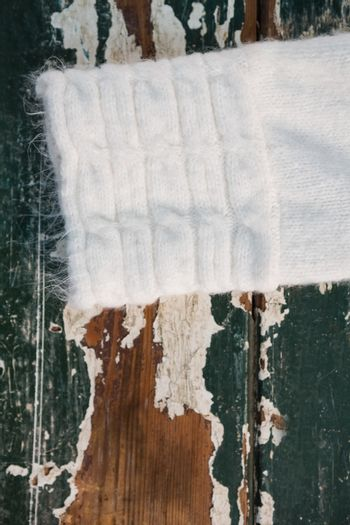 Cropped image of sweater sleeve