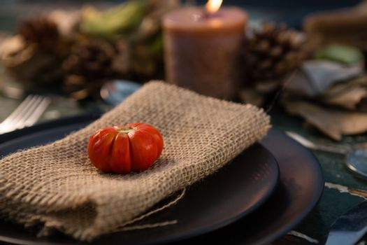 Close up of tomato on burlap in plate