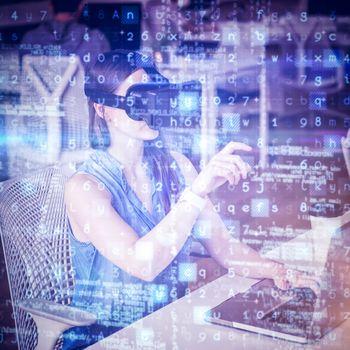 Businesswoman gesturing while wearing virtual reality simulator
