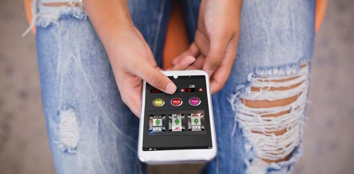 Composite image of slot machine on mobile display