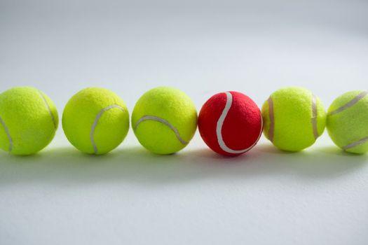 Tennis balls arranged side by side