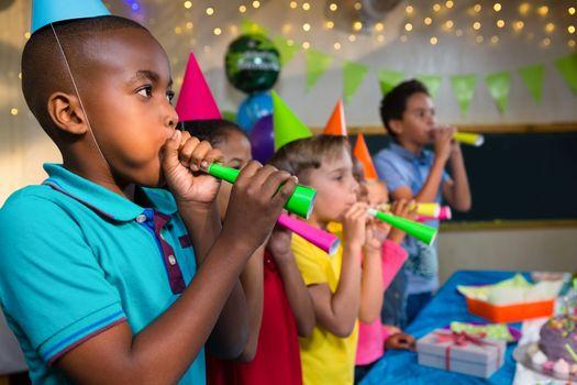 Children blowing party horns