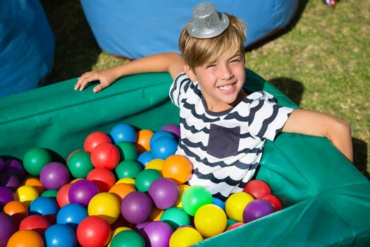 Portrait of smiling boy in ball pool
