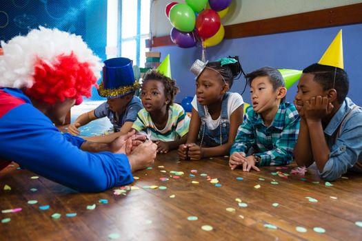 Children looking at clown