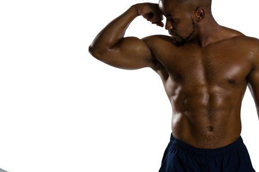 Shirtless sportsman flexing muscles