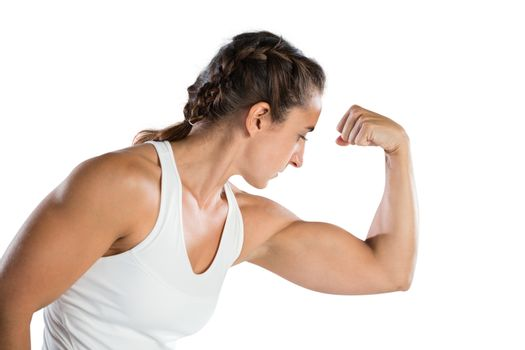 Female athlete flexing muscles
