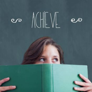 The word achieve against student holding book