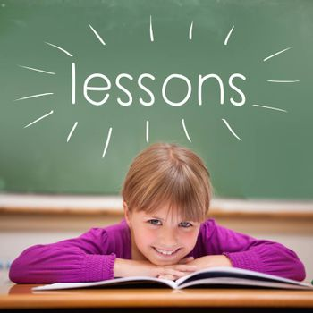 The word lessons against cute pupil sitting at desk