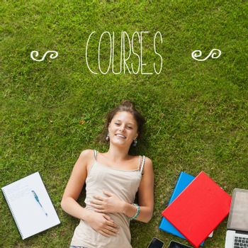 The word courses against pretty student lying on grass