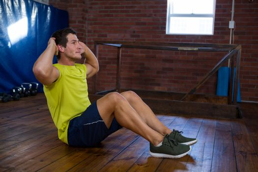 Determined man performing crunches