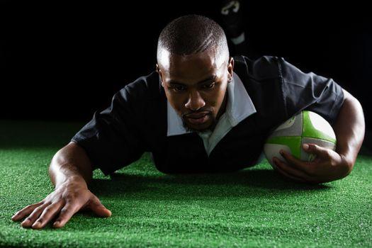 Sportsman making a try on field