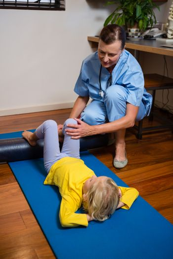 Physiotherapist giving physical therapy to the girl
