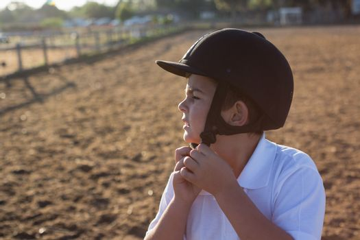 Boy removing helmet