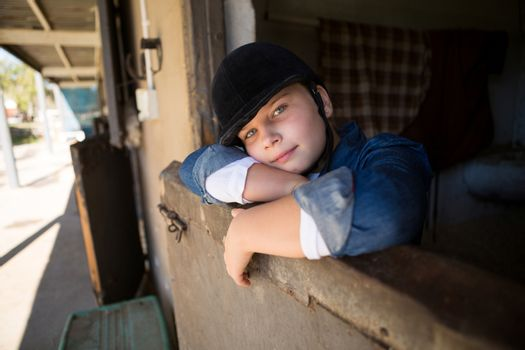 Girl relaxing in the stable