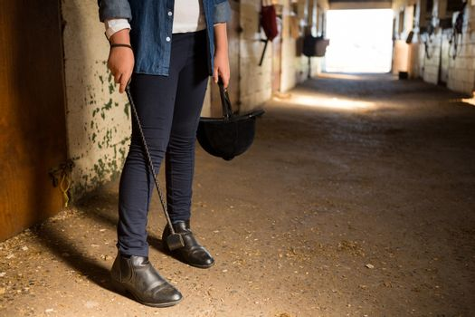 Girl standing in the stable